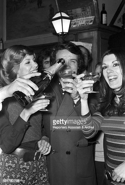 Italian singer Caterina Caselli cheering for the finale of Canzonissima with Italian singer Massimo Ranieri Roma 1970