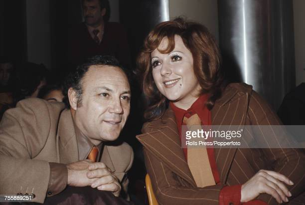 Italian singer Claudio Villa pictured with Italian singer and actress Orietta Berti at a party in Italy in 1972