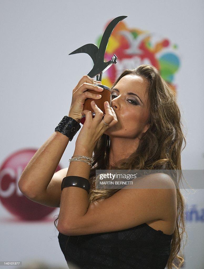 Italian singer Denise Faro show a silver seagull award during the 53nd Vina del Mar International Song Festival on February 27, 2012 in Vina del Mar, Chile.Faro won a International Song Festival .
