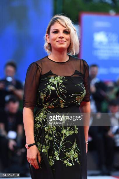 Italian singer Emma Marrone wearing a JaegerLeCoultre RendezVous Night Day watch walks the red carpet during the 'The Shape of Water' premiere during...