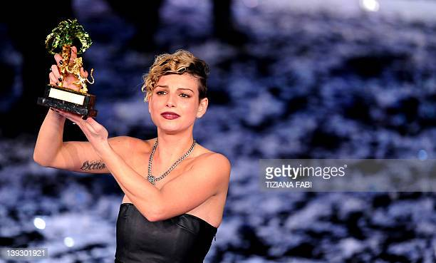 Italian singer Emma poses with her prize at the Ariston Theatre in Sanremo on February 182012 at the 62nd Italian Music Festival in Sanremo AFP...