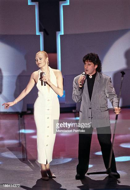 Italian singer Fausto Leali and Italian singer Anna Oxa performing on stage at the 39th Sanremo Music Festival The duo wins the festival for the song...