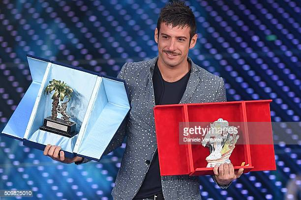 Italian singer Francesco Gabbani winner of Nuove Proposte category of the 66th Italian Music Festival in Sanremo poses with his trophy at the Ariston...
