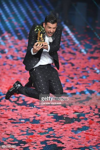 Italian singer Francesco Gabbani winner of the 67th Italian Music Festival in Sanremo pose with the award at Teatro Ariston on February 11 2017 in...
