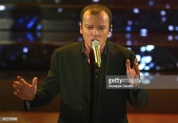 Italian singer Gigi D'Alessio performs at the second day of the San Remo Festival at the Ariston Theatre on March 2 2005 in San Remo Italy The...