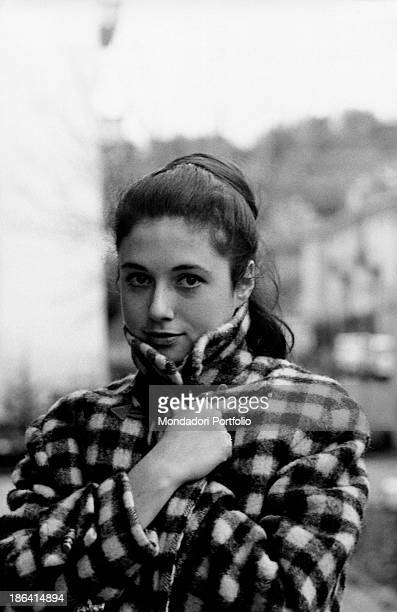 Italian singer Gigliola Cinquetti wrapping herself in a coat 1960s
