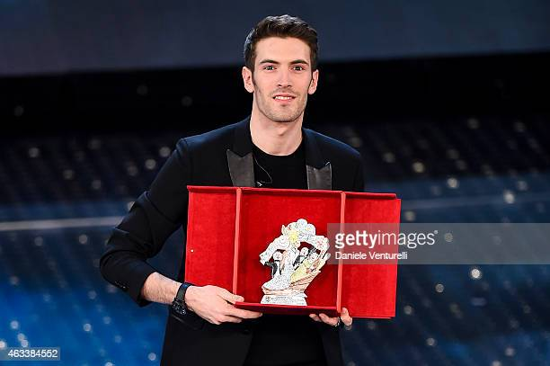 Italian singer Giovanni Caccamo winner of the 65th Italian Music Festival in Sanremo poses with his trophy at the Ariston theatre during the Fourth...