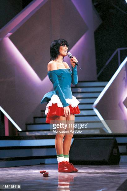 Italian singer Loredana Berté dressed with the colours of the Italian flag performing the song Io at the 38th Sanremo Music Festival Sanremo 1988