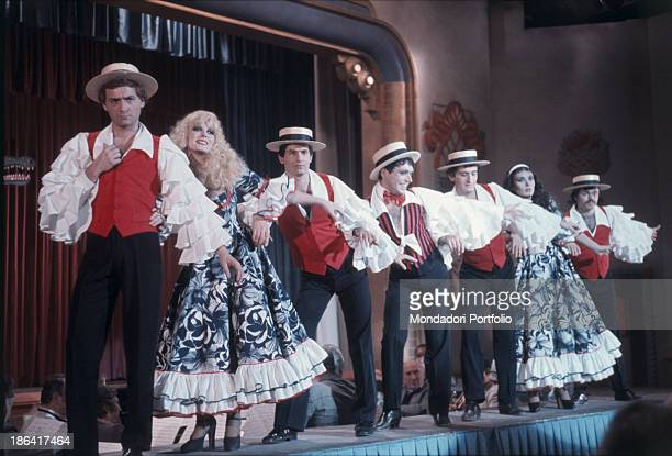 Italian singer Loredana Berté Italian showgirl Isabella Biagini and Italian director TV writer and choreographer Sergio Japino in stage costumes...