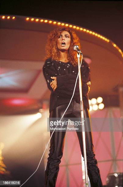 Italian singer Loredana Berté performing a song wearing a pair of leather pants 1982