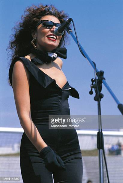 Italian singer Loredana Berté singing wearing a lownecked tightfitting jumpsuit 1982