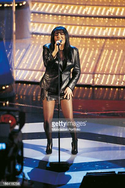 Italian singer Loredana Berté wearing a black leather suit performing the song Luna at the 47th Sanremo Music Festival Sanremo 1997