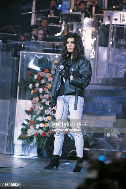 Italian singer Loredana Berté wearing a leather jacket taking part on the 41st Sanremo Music Festival with the song In questa città Sanremo 1991