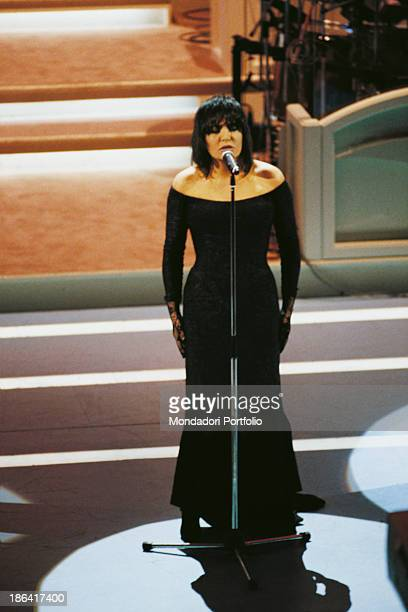 Italian singer Loredana Berté wearing a long black dress performing the song Amici non ne ho at the 44th Sanremo Music Festival Sanremo 1994