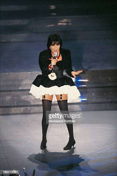 Italian singer Loredana Berté wearing garter and pannier performing the song Io at the 38th Sanremo Music Festival Sanremo 1988