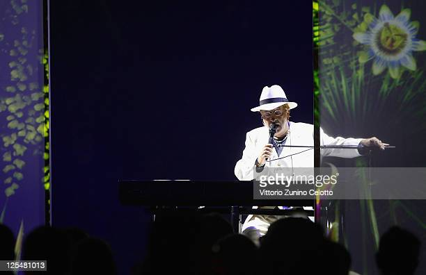 Italian singer Lucio Dalla performs on stage during the new High Jewellery Collection Sortilege de Cartier launch dinner at Villa Aurelia on...