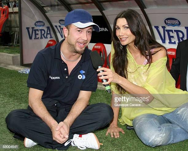 Italian singer Marco Masini is interviewed by Luisa Corna at the Charity Football match event at San Siro stadium on May 31 2005 in Milan Italy Part...