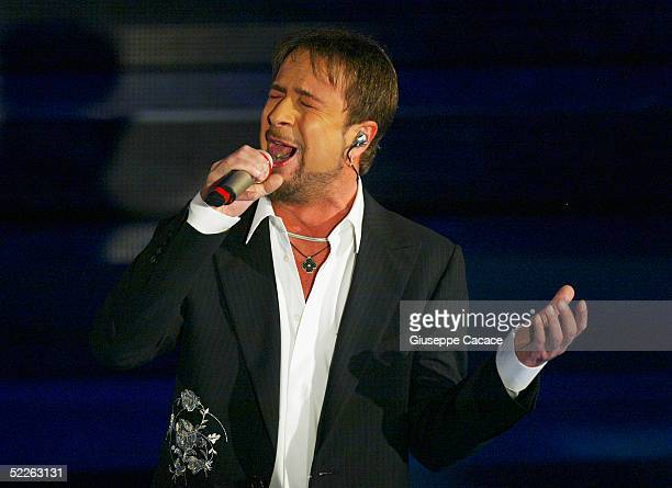 Italian singer Marco Masini performs at the first day of the San Remo Festival at the Ariston Theatre on March 1 2005 in San Remo Italy The fiveday...