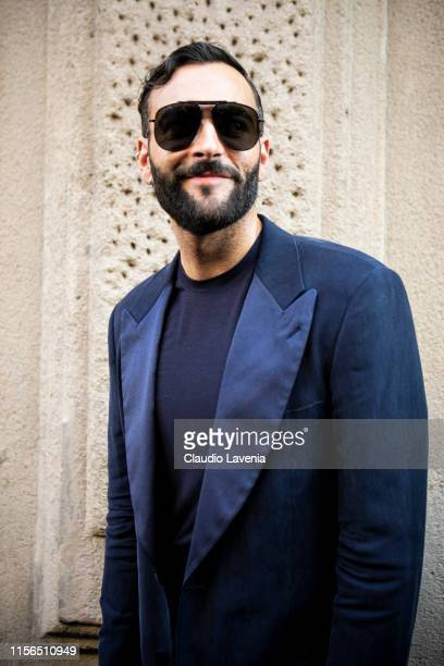 Italian singer Marco Mengoni is seen outside Giorgio Armani show during the Milan Men's Fashion Week Spring/Summer 2020 on June 17, 2019 in Milan,...