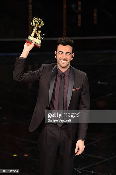 Italian singer Marco Mengoni winner of the 63th Italian Music Festival in Sanremo poses with his trophy at the Ariston theatre during the closing...