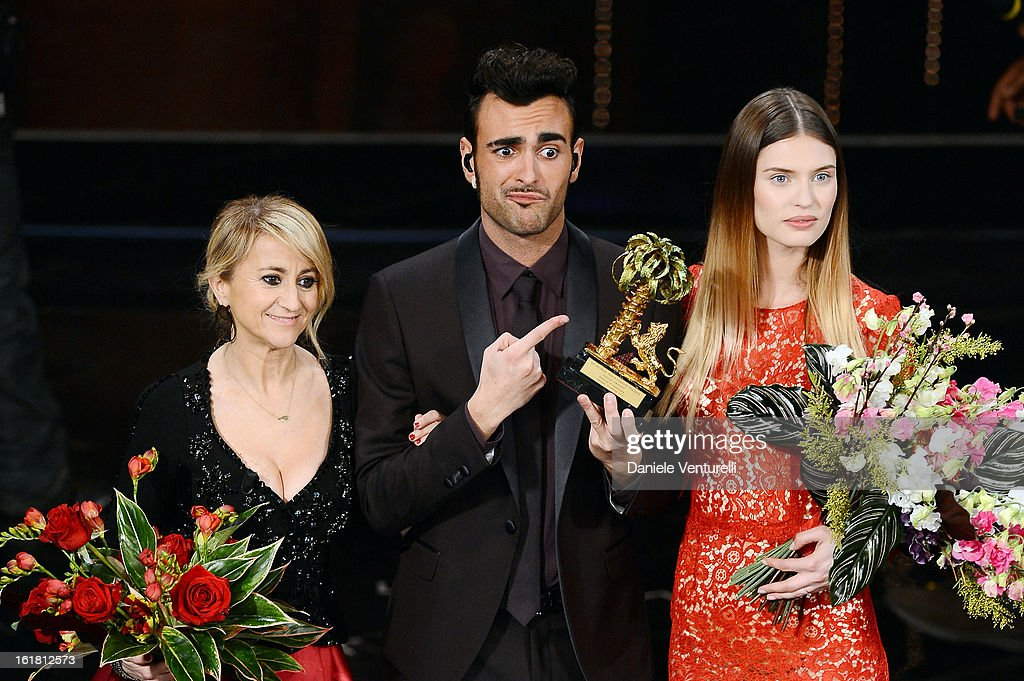 Italian singer Marco Mengoni, winner of the 63th Italian Music Festival in Sanremo, pose with his trophy with Luciana Littizzetto and Bianca Balti at the Ariston theatre during the closing night on February 16, 2013 in Sanremo, Italy.