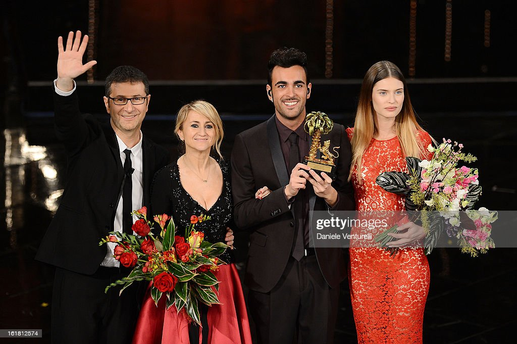 Italian singer Marco Mengoni, winner of the 63th Italian Music Festival in Sanremo, pose with his trophy with Fabio Fazio, Luciana Littizzetto and Bianca Balti at the Ariston theatre during the closing night on February 16, 2013 in Sanremo, Italy.
