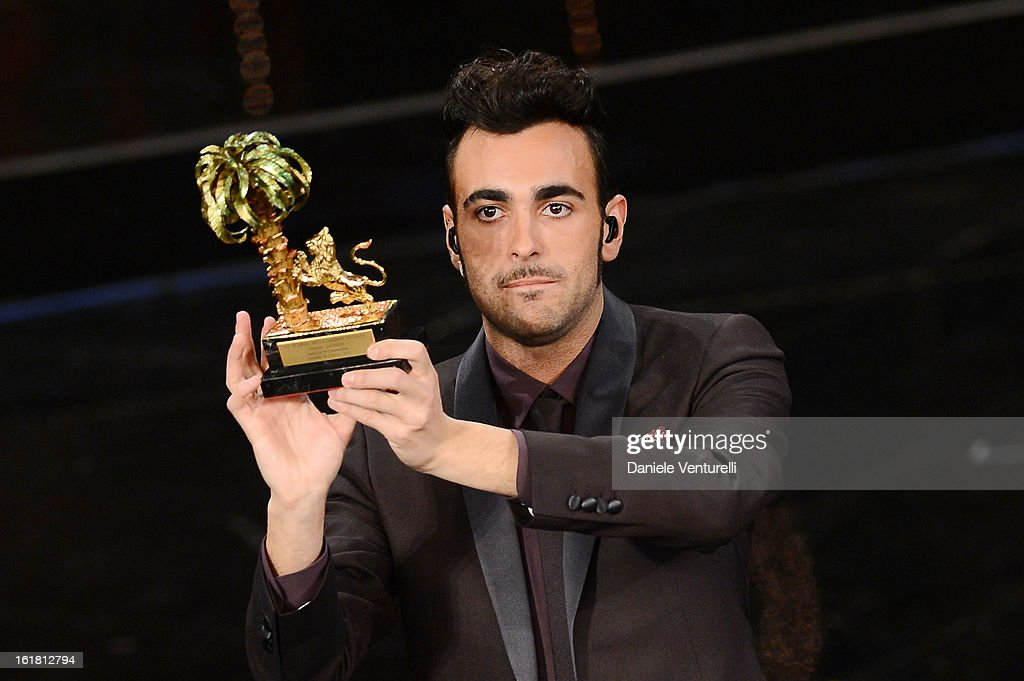 Italian singer Marco Mengoni, winner of the 63th Italian Music Festival in Sanremo, poses with his trophy at the Ariston theatre during the closing night on February 16, 2013 in Sanremo, Italy.