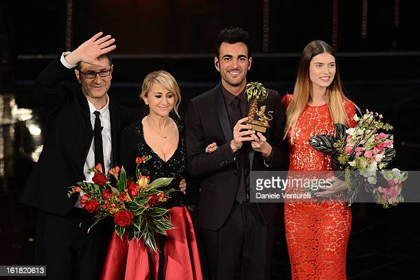 Italian singer Marco Mengoni, winner of the 63th Italian Music Festival in Sanremo, pose with his trophy with Fabio Fazio, Luciana Littizzetto and...