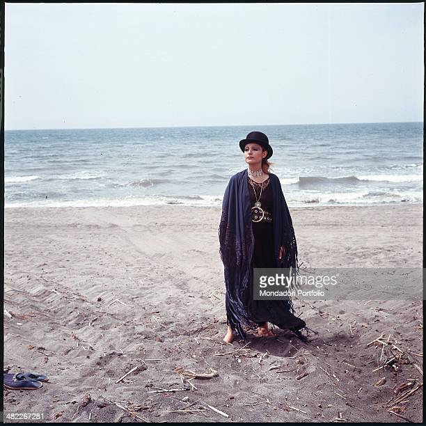 Italian singer Mia Martini posing by the sea 1971