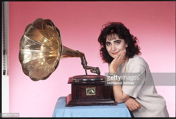 Italian singer Mia Martini posing next to a gramophone during the 42nd Sanremo Music Festival Sanremo February 1992