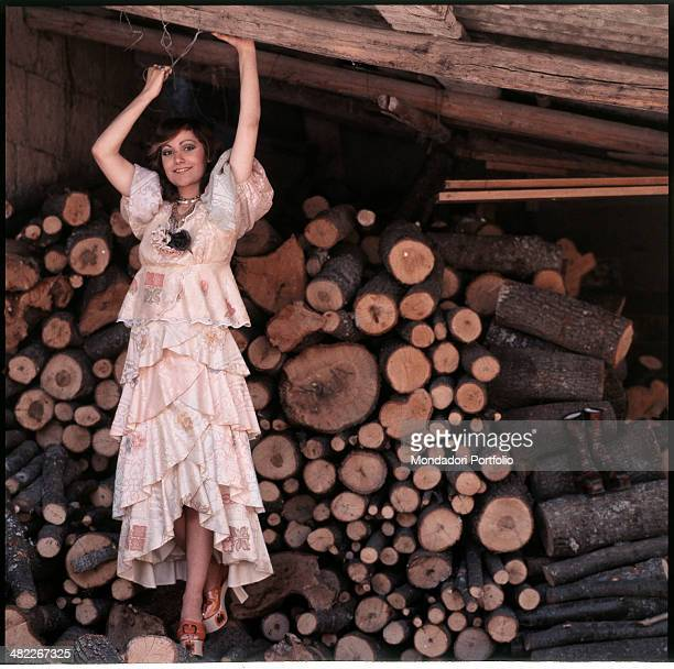 Italian singer Mia Martini posing smiling and with raised arms 1973