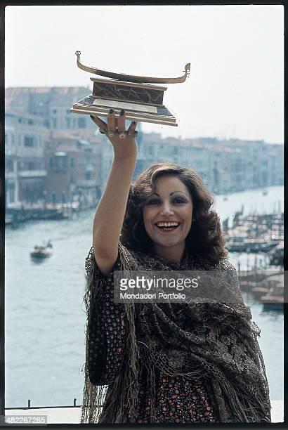 Italian singer Mia Martini raising the Gondola d'Oro prize won at the Mostra Internazionale di Musica Leggera with the song Donna Sola Venice 1973
