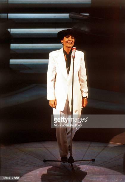 Italian singer Mia Martini singing Gli uomini non cambiano at the 42nd Sanremo Music Festival Sanremo February 1992