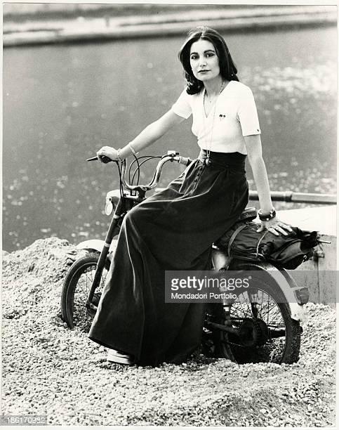 Italian singer Mia Martini sitting on a motorbike Milan 1970s