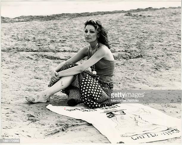 Italian singer Mia Martini sitting on the beach Grado 1970s