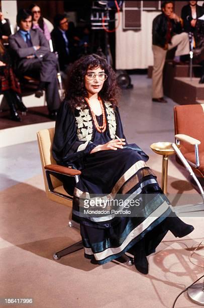 Italian singer Mia Martini smoking a cigarette in the studios of the TV show Ieri e oggi Italy 1979