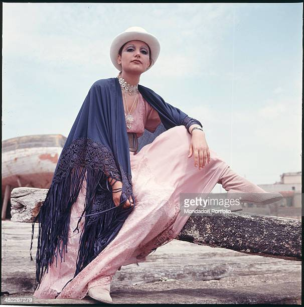 Italian singer Mia Martini wearing a shawl and a hat 1971