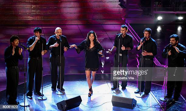 Italian singer Mietta performs on stage with Italian band Neri Per Caso at the Teatro Ariston during the 58th San Remo Music Festival on February 28...
