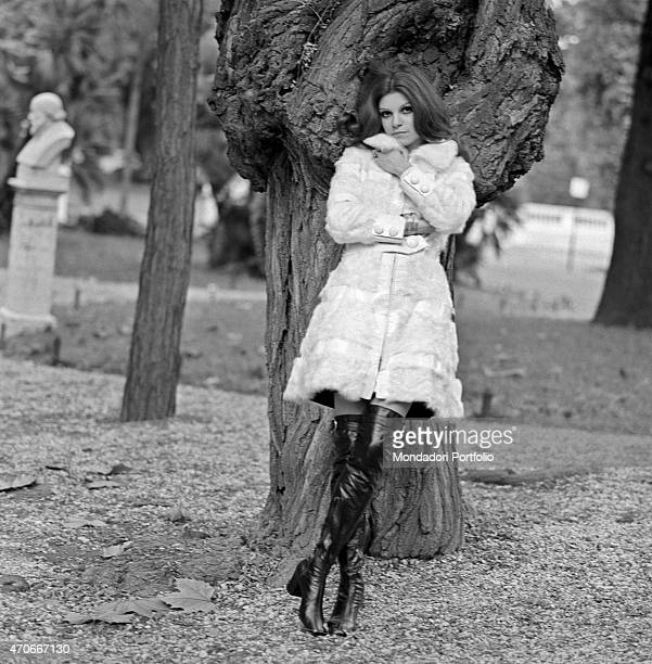 'Italian singer Milva born Maria Ilva Biolcati is in a park and leans herself against a tree she is nicknamed The Panther from Goro thanks to her...