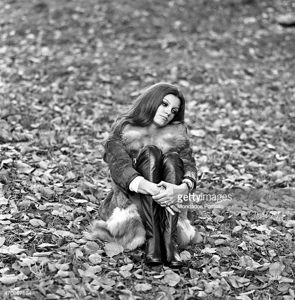 'Italian singer Milva born Maria Ilva Biolcati is thoughtful and seated on the ground in a park among the dead leaves she is nicknamed The Panther...
