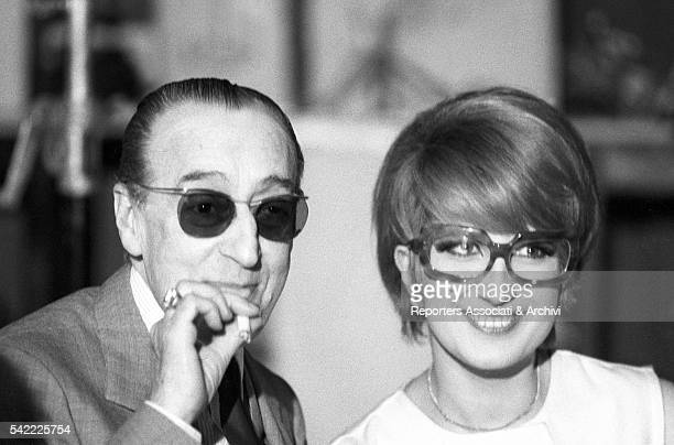 Italian singer Mina and Italian actor Totò smiling during a TV show 1965