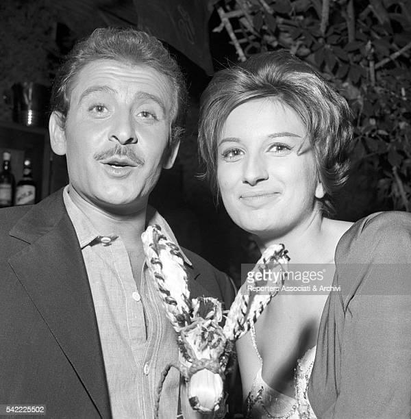 Italian singer Mina and Italian songwriter Domenico Modugno during a break on the set of Appuntamento a Ischia 1960
