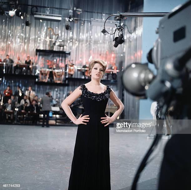 Italian singer Mina born Mina Anna Maria Mazzini in front of the camera into the TV studio of the variety Studio Uno in which she takes care of the...