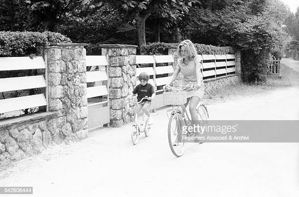 Italian singer Mina cycling with her son Massimiliano Viareggio July 1969