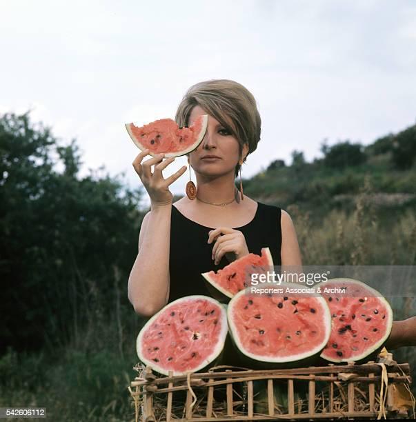 Italian singer Mina eating watermelon during the Summer Autoraduno Italy 1968
