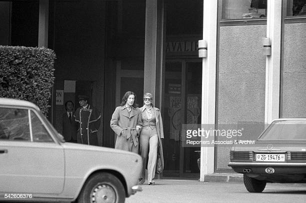 Italian singer Mina holding arms with Italian music producer Alfredo Cerruti January 1974
