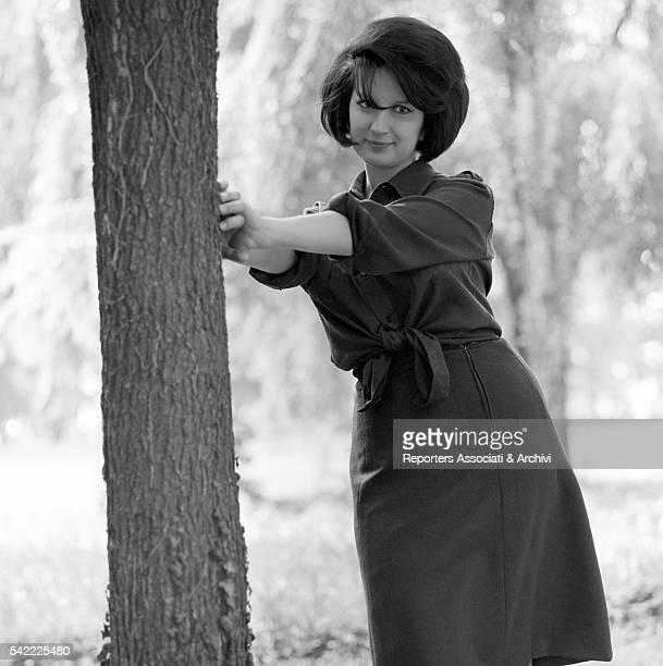 Italian singer Mina leaning on a tree on a movie set Milan 1963