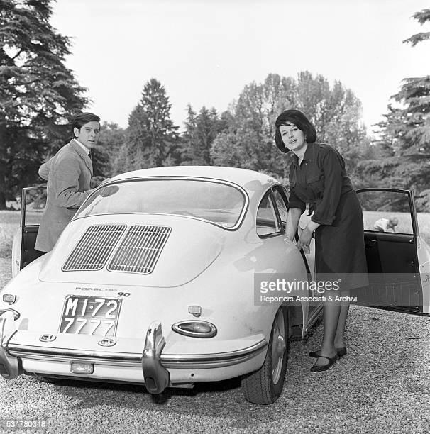 Italian singer Mina Mazzini and Italian actor Corrado Pani getting out of their car Italy 1960