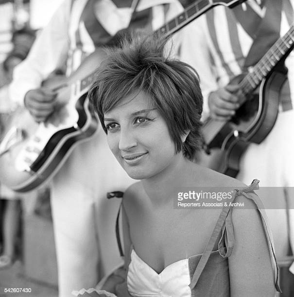 Italian singer Mina performing on a beach 1959