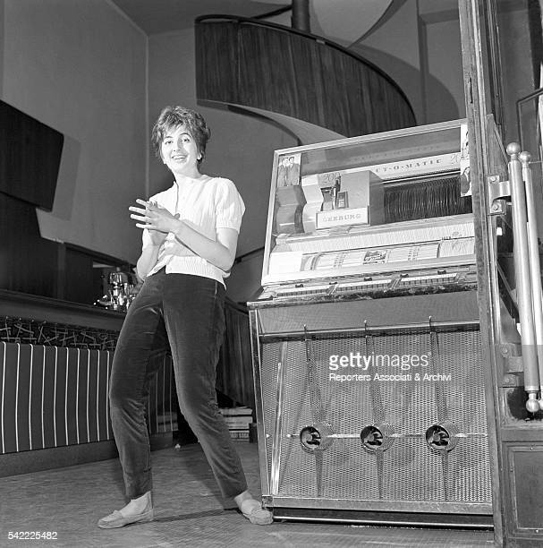 Italian singer Mina posing with a Juke box 1960